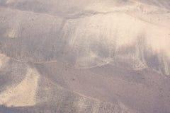 Strandpatroon door golven op zand Royalty-vrije Stock Fotografie