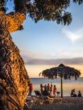 Strandplats på solnedgången Arkivbild