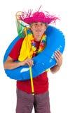 Strandpojke med den blåa floaten arkivfoton