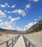 Strandpromenad i Cala Domestica Royaltyfria Foton