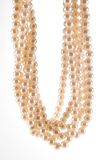 Strands of Pearls. Several strands of pearls twist together to make a single necklace hanging in a loop Stock Photos