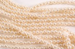 Strands of Pearls. Several strands of pearls laying flat on a white background Royalty Free Stock Image