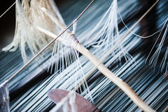Strands in Songket Factory. View of strands on a traditional Songket weaving platform Stock Image