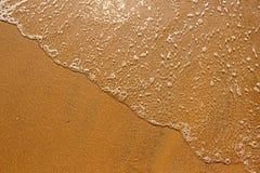 Strandsand an der Küste Stockbild