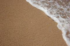 Strandsand und Meerwasser Lizenzfreies Stockfoto