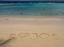 Strandsemesterort - sandmeddelande Arkivfoton