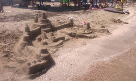 strandslott som göras sanden att skulptera form Arkivbild