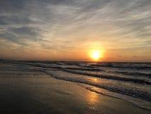 strandsoluppgång Arkivfoto