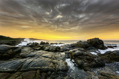 Strandsoluppgång, Sydafrika arkivbild