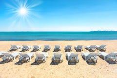 Strandstolar på stranden Fotografering för Bildbyråer
