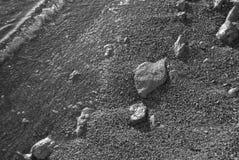 Strandzand en rotsenclose-up Stock Afbeelding