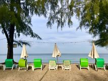 Strandzetel op het strandbehang Stock Foto