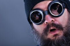 Strange beard man viewing explosive situation or offer - closeup Stock Photo