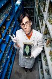 Strange biologist. Holding fish in formalin Stock Photos