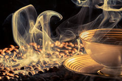 Strange blue smoke taking away from coffee seeds stock images