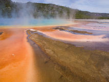 Strange Brew. Run off from the Grand Prismatic Spring in Yellowstone National Park. The unusual coloration of the microbial `mats` depends on the combination of royalty free stock photos