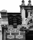 Strange characters on top of the building. Shot in black and white, detail on the sculpture on the facade of this historic building representing some characters Royalty Free Stock Images
