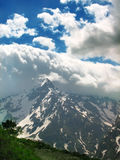 Strange cloud formations above the mountains. Amazing cloud look like tsunami wave. Sunny day. Caucasus mountains Royalty Free Stock Photos