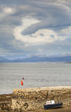Strange cloud  on the Isle of Skye. Strange cloud and coastline at Broadford harbour on the Isle of Skye Stock Image