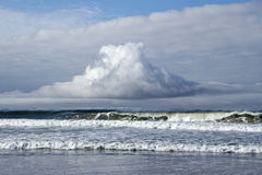Strange cloud over waves Stock Photos