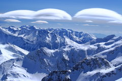 Strange clouds. Strange shape clouds view from Schareck peak, Moltaller Gletcher, Austria Royalty Free Stock Image