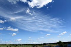 Strange clouds. Unusual white clouds against the blue sky Royalty Free Stock Images