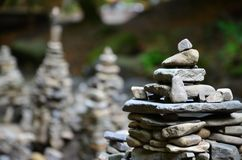 A strange composition of small mountain rocks. imitation of ancient buildings on a reduced scale.  Stock Images