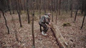 Strange correspondent reporter finds jar of canned mushrooms. Hunter forest ranger dressed in camouflage suit tells