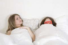 Strange couple lying in bed Royalty Free Stock Image