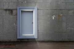 Strange door. An open door in abandoned space emits light Stock Photos