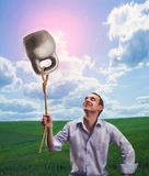 Strange dreamy man with a kettlebell Stock Image