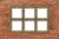 Strange empty golden frame over brick wall Stock Image
