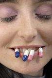 Strange face with pills. Young woman's strange face with pills Stock Photo