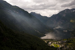 Strange feel on the fjord. Photo of geiranger token from a high point of view while a strange ominous and beautiful feel waft on the fjord Stock Photo