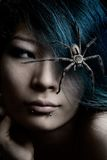 Strange friends. Portrait of model with spider in hair royalty free stock image