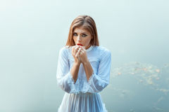 Strange girl in a white dress. Stock Image