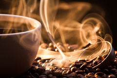 Strange Golden Smoke Taking Away From Coffee Seeds Royalty Free Stock Images