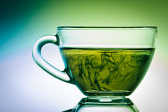 Strange green tea in small cup Royalty Free Stock Photo