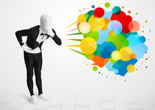 Strange guy in morphsuit looking at colorful speech bubbles Royalty Free Stock Images