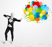 Strange guy in morphsuit looking at colorful speech bubbles Stock Photos