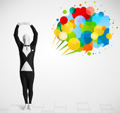 Strange guy in morphsuit looking at colorful speech bubbles Royalty Free Stock Photo