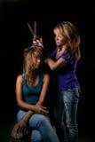 Strange hair-stylist Stock Image