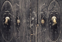 Strange handle. Handles on a wooden door looking like hands Royalty Free Stock Photo