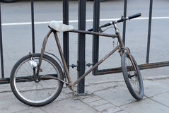 Strange handmade custom modding bicycle on moscow street locks to the fence Stock Image