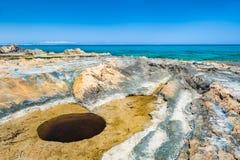 Strange hole on the beach of Malia. Crete island, Greece Stock Images