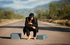 Strange indigenous man in the middle of a road Stock Images
