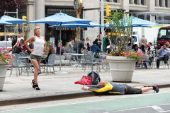 Strange kind of shooting on the street with mobile phone. NEW YORK CITY - JUNE 16, 2015: strange kind of shooting on the street with mobile phone Royalty Free Stock Images