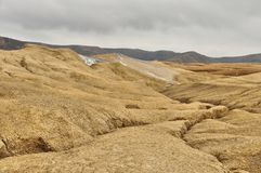 Strange landscape by active mud volcanoes. Stock Photography