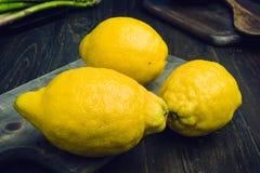 Strange lemons on wooden board Royalty Free Stock Photography
