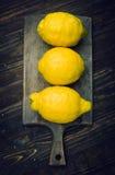 Strange lemons on wooden board Royalty Free Stock Image